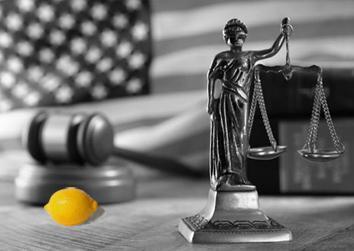 Yellow lemon beside gavel